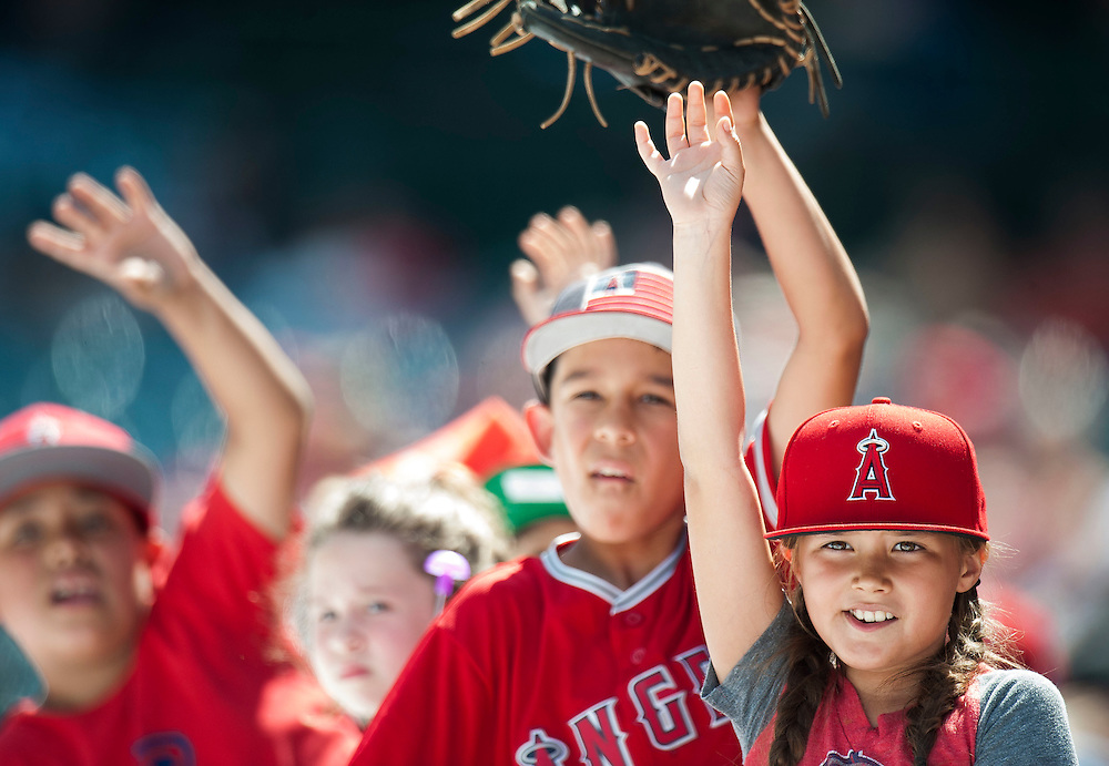 Angel fans look for baseballs during the Angels' preseason game against the Chicago Cubs at Angel Stadium Sunday.<br /> <br /> <br /> ///ADDITIONAL INFO:   <br /> <br /> angels.0404.kjs  ---  Photo by KEVIN SULLIVAN / Orange County Register  --  4/3/16<br /> <br /> The Los Angeles Angels take on the Chicago Cubs at Angel Stadium during a preseason game at Angel Stadium Sunday.<br /> <br /> <br />  4/3/16