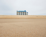 OCEAN CITY, MD - APRIL 23: The Belmont Towers Resort is seen across an empty beach on April 23, 2020 in Ocean City, Maryland. The coronavirus pandemic shut down the city just before Easter Sunday which usually marks the beginning of the tourist season. Many hotel, restaurant, and tourism industry workers rely on the seasonal business during the warm months to provide most of their yearly income. (Photo by Samuel Corum/Getty Images)