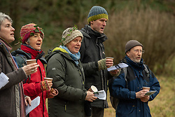 People of all ages gathered this afternoon in Portobello's Community Orchard at Donkeyfield by Brunstane to sing some wassailing songs. The songs, a mixture of traditional and more modern, were originally sung in orchards at this time of year to mark the start of the new year and encourage a good growing season. Members of Portobello's Community Choir, led by Jane Lewis, sang along with other locals and enjoyed drinks made from apples gathered in the orchard in what is now an annual tradition at the orchard. <br /> © Jon Davey/ EEm