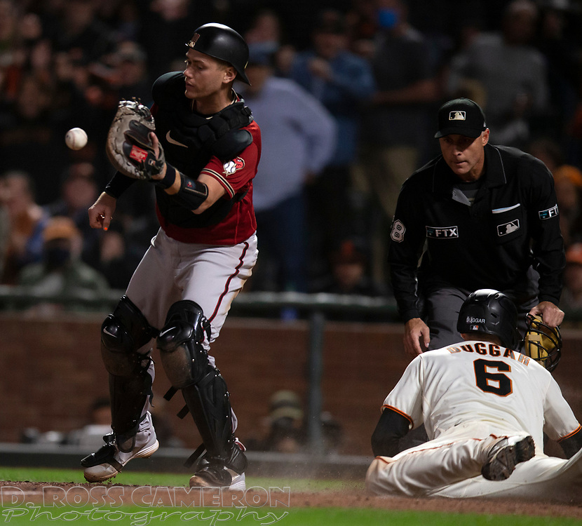 Sep 29, 2021; San Francisco, California, USA; San Francisco Giants outfielder Steven Duggar (6) slides safely home on a sacrifice fly while Arizona Diamondbacks catcher Carson Kelly (18) during the seventh inning at Oracle Park. Umpire is Dan Iassogna. Mandatory Credit: D. Ross Cameron-USA TODAY Sports