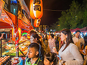 06 FEBRUARY 2014 - HAT YAI, SONGKHLA, THAILAND: People wait for food at a food stall during Lunar New Year in Hat Yai. Hat Yai was originally settled by Chinese immigrants and still has a large ethnic Chinese population. Chinese holidays, especially Lunar New Year (Tet) and the Vegetarian Festival are important citywide holidays.     PHOTO BY JACK KURTZ