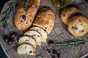 Olive Bread on wood cutting board.