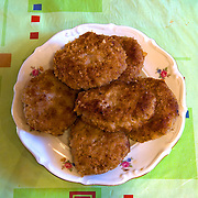 Mielone Klops  - Polish fried hamburgers <br /> Serves 3 <br /> <br /> Ingredients: 700gr minced pork potatoes  <br /> 1 loaf dry bread<br /> 1 egg<br /> ¼ teaspoon salt<br /> ¼ teaspoon black pepper <br /> 1 clove of garlic<br /> vegetable oil<br /> <br /> <br /> Preparation :<br /> 1.Soak ¾ of the bread in water until soft <br /> 2.Grind the rest of the bread to make bread crumbles <br /> 3.Mix the soaked bread with the meat and the other ingredients<br /> 4.Make the burgers and coat them with bread crumbles <br /> 5.In a pan add enough vegetable oil to cover the burger and fry the burgers until ready<br /> 6.Turn occasionally