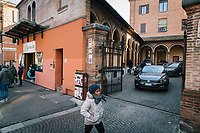 BOLOGNA, ITALY - 6 JANUARY 2020: A woman walks by the entrance of the theater of the Istituto Antoniano, an institution governed by Franciscan friars as  a community service initiative that temporarily rented its theater to a  police union to host a party organised for the childen of police officers during the holidays in Bologna, Italy, on January 6th 2020. The police union invited Matteo Salvini raising criticism since the Istituto Antoniano was previsouly a migrant center until Mr. Salvini became Interior Minister and changed the application requirements in his anti-migrants security decree, which the institution didn't agree with, therefore choosing not to apply and closing the center.<br /> <br /> Matteo Salvini is campaigning in the region of Emilia Romagna to support the League candidate Lucia Borgonzoni running for governor.<br /> <br /> After being ousted from government in September 2019, Matteo Salvini has made it a priority to campaign in all the Italian regions undergoing regional elections to demonstrate that, in power or not, he still commands considerable support.<br /> <br /> The January 26th regional elections in Emilia Romagna, traditionally the home of the Italian left, has been targeted by Matteo Salvini as a catalyst for bringing down the government. A loss for the center-left Democratic Party (PD) against Mr Salvini's right would strip the centre-left party of control of its symbolic heartland, and probably trigger a crisis in its coalition with the Five Star Movement.