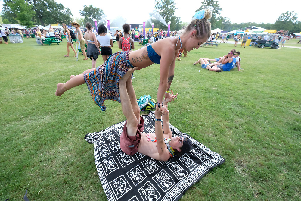 A young couple passes the time in between concerts at Bonnaroo