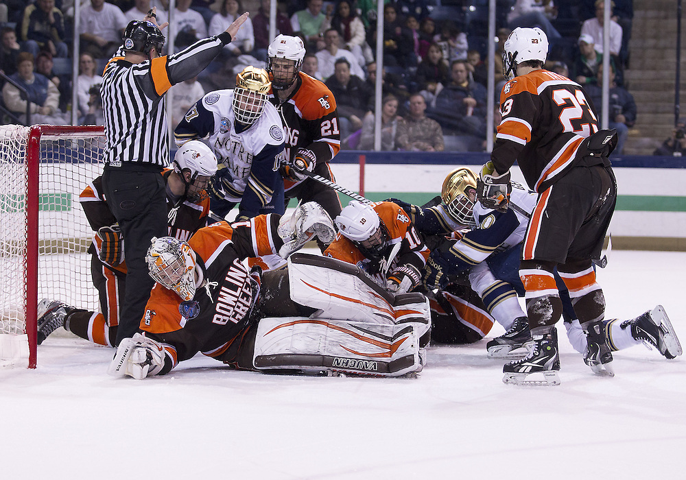March 15, 2013:  Bowling Green goaltender Andrew Hammond (1) makes the save as players pile up in the crease during NCAA Hockey game action between the Notre Dame Fighting Irish and the Bowling Green Falcons at Compton Family Ice Arena in South Bend, Indiana.  Notre Dame defeated Bowling Green 1-0 in overtime.