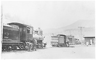 """RGS 2-8-0 #12 with unidentified locomotive.  Flags on 2nd locomotive indicate that it ran backwards.  Possibly will haul #12 back to Ridgway.<br /> RGS  Placerville, CO  Taken by Virden, Walter - ca 1910-1915<br /> In book """"Southern, The: A Narrow Gauge Odyssey"""" page 104<br /> Also in """"RGS"""", p. 57."""