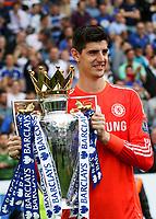 Football - 2014 / 2015 Premier League - Chelsea vs. Sunderland.   <br /> <br /> Chelsea's Thibaut Courtois  with the Premier League Trophy at Stamford Bridge. <br /> <br /> COLORSPORT/DANIEL BEARHAM