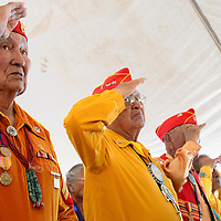 081414  Adron Gardner<br /> <br /> U.S. Marine Corps Code Talkers salute as the color guard presents the American Flag during Code Talker day in Window Rock Thursday.