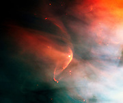 Named for the crescent-shaped wave a ship makes as it moves through water, a bow shock can form in space when two gas streams collide. In this case, the young star, LL Ori, emits a vigorous wind, a stream of charged particles moving rapidly outward from the star. Hubble Space Telescope (HST).