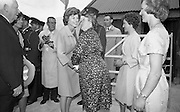 Kennedy in Ireland.  President Kennedy visits the homestead of his great-grandfather at Dunganstown, Co. Wexford and drinks a cup of tea with the present owner of the cottage, a second cousin of the President, Mrs. Mary Ryan (neé Kennedy)..26.06.1963. President Kennedy's visit to New Ross, County Wexford, Ireland.