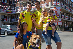 Outnumbered but hoping for victory, A Colombian family and their dog Troy are pictured on the Kirby Estate in Southwark where local residents have put on a huge display of support for England in the World Cup. PICTURED: Mother Sandra Ramos, 48, her Grand-daughter Adeline, seven months, her Son Jean-Paul Jhonnes, 19, Daughter Alejandra Ramos, 29 - mother of Adeline - and her brother Kevin Jhonnes, 18, with Troy their American Boxer Dog . London, July 02 2018.