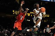 Southern Methodist Mustangs guard Emmanuel Bandoumel (5) guards Vanderbilt Commodores guard Saben Lee (0) during an NCAA basketball game between the Southern Methodist University Mustangs and the Vanderbilt University Commodores at Memorial Gymnasium in Nashville, TN
