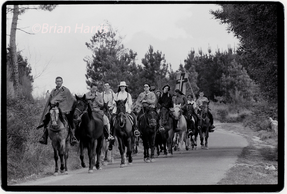 """Camino de Santiago_Way of St James August 1989<br />Pilgrims on horses horse back, ride on a horse, <br /> make their way to Santiago de Compostela for the 4th World Youth Day presided over by Pope John Paul II during 19-21 August 1989.<br />The Camino de Santiago (Latin: Peregrinatio Compostellana, """"Pilgrimage of Compostela""""; Galician: O Camiño de Santiago),[1] known in English as the Way of St. James, is a network of pilgrims' ways or pilgrimages leading to the shrine of the apostle Saint James the Great in the cathedral of Santiago de Compostela in Galicia in northwestern Spain, where tradition holds that the remains of the saint are buried. Many follow its routes as a form of spiritual path or retreat for their spiritual growth."""