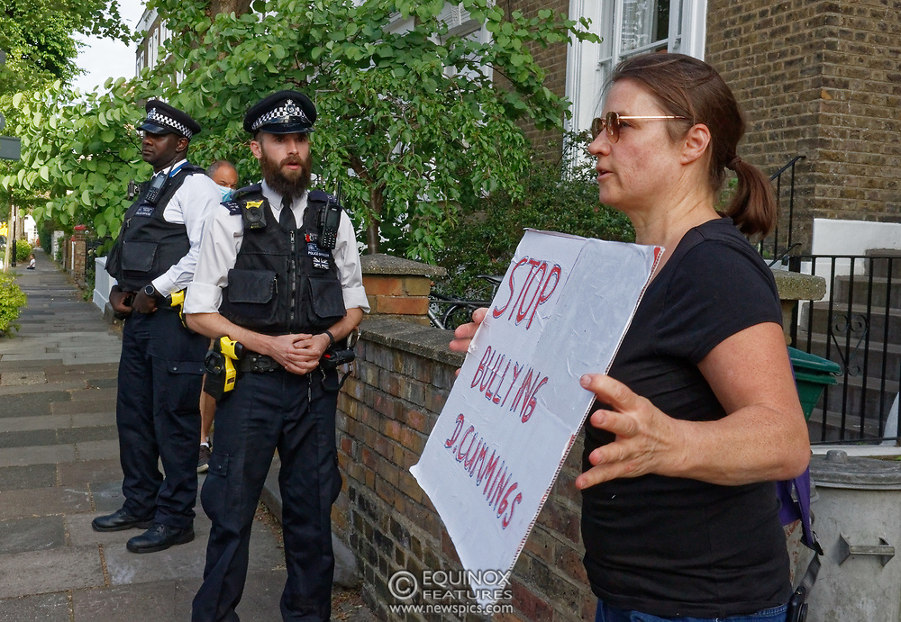 London, United Kingdom - 26 May 2020<br /> The scene at Dominic Cummings home in North London today where the police monitored the street and two or three supporters turned up to support of him as he arrived home. Islington, London, England, UK.<br /> **VIDEO AVAILABLE**<br /> (photo by: EQUINOXFEATURES.COM)<br /> Picture Data:<br /> Photographer: Equinox Features<br /> Copyright: ©2020 Equinox Licensing Ltd. +443700 780000<br /> Contact: Equinox Features<br /> Date Taken: 20200526<br /> Time Taken: 17580800<br /> www.newspics.com