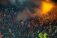 Hearts fans let off a smoke canister during the Ladbrokes Scottish Premiership match between Livingston FC and Heart of Midlothian FC at the Tony Macaroni Arena, Livingston, Scotland on 14 December 2018.