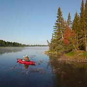 Dan shooting from a kayak on Island Lake in Minnesota.