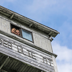 A boy and girl look out of the fire tower on Deboullie Mountain in Aroostook County, Maine. Deboullie Public Reserve Land.