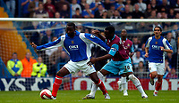 Photo: Alan Crowhurst.<br /> Portsmouth v West Ham United. The Barclays Premiership. 14/10/2006. Andy Cole (L) of Portsmouth with Nigel Reo-Coker.