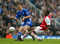 Photo: Scott Heavey.<br /> Arsenal v Chelsea. FA Cup 5th Round. 15/02/2004.<br /> Patrick Vieira lands on the ankle off Scott Parker