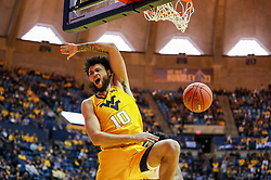 Feb 2, 2019; Morgantown, WV, USA; West Virginia Mountaineers guard Jermaine Haley (10) dunks the ball and celebrates during the second half against the Oklahoma Sooners at WVU Coliseum. Mandatory Credit: Ben Queen-USA TODAY Sports
