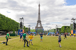 Ireland fans play football in the Paris Fanzone at the Eiffel Tower, while waiting for the next game to start on the big screens. Images from the UEFA EURO 2016, 14 June 2016 in Fan Zone. (c) Paul Roberts   Edinburgh Elite media. All Rights Reserved