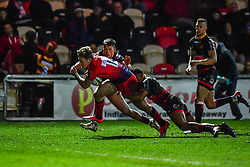 Tom Howe of Worcester Warriors is tackled by Ashton Hewitt of Dragons - Mandatory by-line: Craig Thomas/JMP - 02/02/2018 - RUGBY - Rodney Parade - Newport, Gwent, Wales - Dragons v Worcester Warriors - Anglo Welsh Cup
