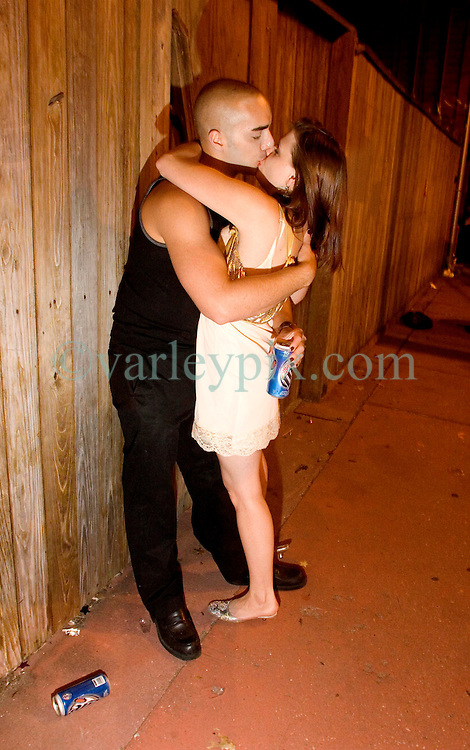 October 31, 2005. New Orleans, Louisiana. <br /> Halloween, post Katrina, New Orleans. As the city returns to a strange sense of normalcy and the citizens return, New Orleans once again hosts a Halloween parade and party.A couple kiss on Frenchman Street.  <br /> Photo; ©Charlie Varley/varleypix.com