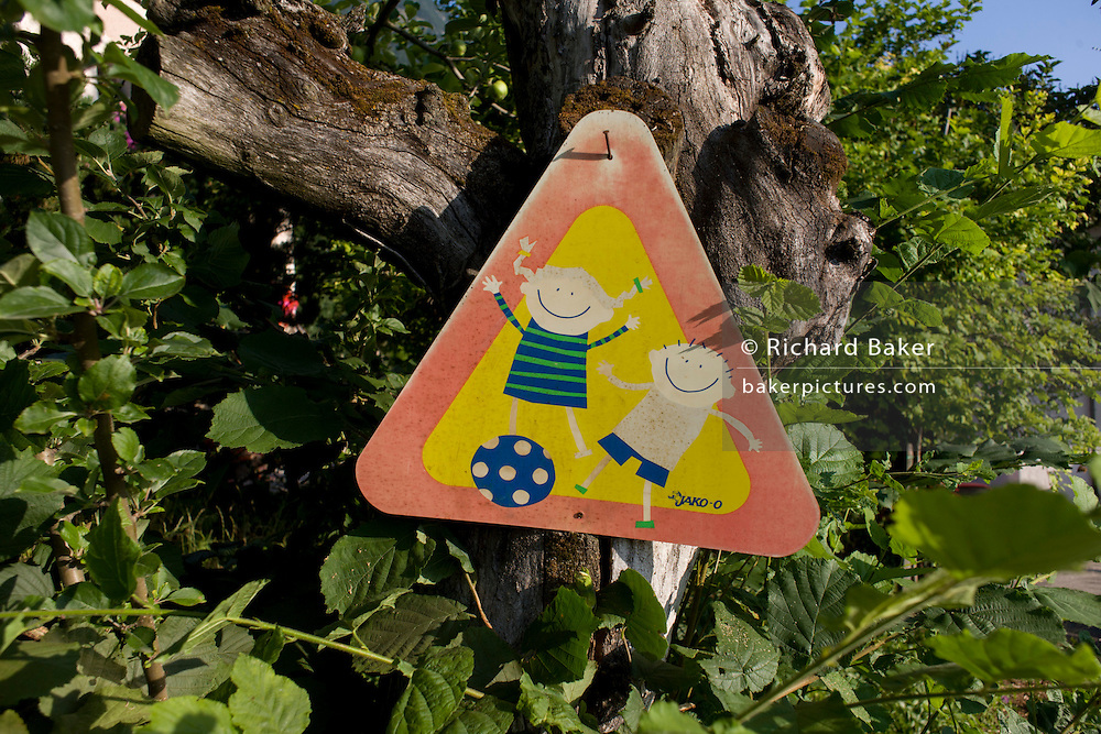 A children playing warning sign in a rural location in northern Italy.