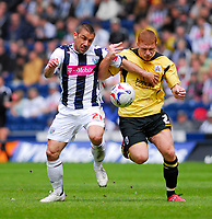 Photo: Leigh Quinnell.<br /> West Bromwich Albion v Barnsley. Coca Cola Championship. 06/05/2007. West Broms hat trick hero Kevin Phillips battles with Barnsleys Bobby Hassell.