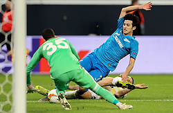 February 21, 2019 - Saint Petersburg, Russia - Zenit St.Petersburg's Iranian forward Sardar Azmoun tries scoring a goal to goalkeeper Harun Tekin of Fenerbahce during the UEFA Europa League round of 32 second leg football match between FC Zenit and Fenerbahce SK in Saint Petersburg on February 21, 2019. (Credit Image: © Igor Russak/NurPhoto via ZUMA Press)