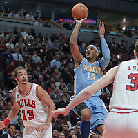 08 November 2010: Denver Nuggets' small forward #15 Carmelo Anthony takes a jumpshot over Chicago Bulls' center #13 Joakim Noah during the Chicago Bulls 94-92 victory over the Denver Nuggets at the United Center, in Chicago, Illinois, USA.