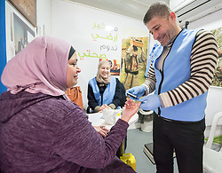 26 February 2020, Abu Dis, Palestine: 43-year-old Intisar Alafandi (left)  from Abu Dis undergoes a glucotest administered by supervisor Ziad Paradiah (right) together with dietitian Samah Khatib (centre) as she visits the Mobile Diabetes Clinic of the Augusta Victoria Hospital for testing. In an effort to make Diabetes services more accessible to people in the West Bank, the Augusta Victoria Hospital offers a Mobile Diabetes Clinic, which moves around to various locations in the West Bank, offering screening and routine testing for Diabietes and the symptoms it causes.
