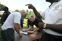 Coach Joe Gibbs signs autographs for inmates following his 'Game Plan for Life' presentation at The Charlotte Correctional Center,  a minimum security prison in Charlotte..           The Coach and NASCAR team owner has recently begun a prison ministry with his inspirational, 'Game Plan for Life', speaking engagements.  <br /> photo by Laura Mueller<br /> www.lauramuellerphotography.com