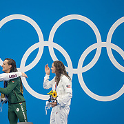 TOKYO, JAPAN - JULY 30:  Gold medal winner Tatjana. Schoenmaker of South Africa is congratulated by bronze medal winner Annie Lazor of the United States and silver medal winner Lilly King of the United States on the podium after the 200m breaststroke for women during the Swimming Finals at the Tokyo Aquatic Centre at the Tokyo 2020 Summer Olympic Games on July 30, 2021 in Tokyo, Japan. (Photo by Tim Clayton/Corbis via Getty Images)