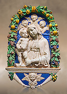 Enamelled terracotta relief panel of the Virgin and Child with Cherubs by Andrea  della Robbia, Florence circa 1435-1525.  Inv  Campana 32,  The Louvre Museum, Paris. .<br /> <br /> If you prefer you can also buy from our ALAMY PHOTO LIBRARY  Collection visit : https://www.alamy.com/portfolio/paul-williams-funkystock/florentine-enamel-antiquities.html <br /> <br /> Visit our MEDIEVAL ART PHOTO COLLECTIONS for more   photos  to download or buy as prints https://funkystock.photoshelter.com/gallery-collection/Medieval-Gothic-Art-Antiquities-Historic-Sites-Pictures-Images-of/C0000gZ8POl_DCqE