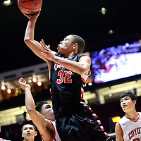 031015  Adron Gardner/Independent<br /> <br /> Grants Pirate Greg Harris (32) scores two points on the Roswell Coyotes during a 4A New Mexico state basketball tournament quarterfinal at The Pit in Albuquerque Wednesday.  The number six ranked Pirates beat the number three ranked Coyotes 76-71.