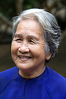 Elderly Vietnamese woman with a stunning Vietnamese smile.  The Mekong Delta is famous not only for its abundant produce, labyrinth of canals and riverine activity, but the warm friendliness of its people.