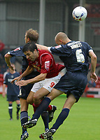 Photo: Paul Thomas.<br /> Walsall v Southend. Coca Cola League 1.<br /> 13/08/2005.<br /> <br /> Gorge Leitao gets caught between the Southend defence.