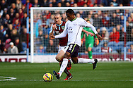 Everton's Samuel Eto'o goes past Burnley's David Jones. Barclays Premier league match, Burnley v Everton at Turf Moor in Burnley, Lancs on Sunday 26th October 2014.<br /> pic by Chris Stading, Andrew Orchard sports photography.