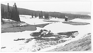 """RGS Goose #5 northbound after exiting the Lizard Head wye snowshed as seen from the highway.<br /> RGS  Lizard Head, CO  Taken by Maxwell, John W. - 5/26/1949<br /> In book """"Rio Grande Southern, The: An Ultimate Pictorial Study"""" page 96"""