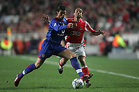 Photo: Lee Earle.<br /> Benfica v Manchester United. UEFA Champions League.<br /> 07/12/2005. United's Cristiano Ronaldo (L) battles with Benfica's Leo.