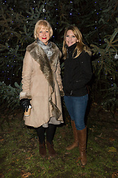 © Licensed to London News Pictures. 08/12/2014. London, UK. Helen Mirren with local councillor for Wapping and St Katharines, Julia Dockerill. Dame Helen Mirren turns on the Christmas tree lights at Wapping Green in Tower Hamlets, East London tonight. This is the first time in many years that Wapping has had a Christmas tree and Dame Helen Mirren surprised residents by turning up at the community event and leading the countdown to switching the tree lights on. She then joined residents singing carols and drinking mulled wine, at the event which was arranged by the local councillor for Wapping and St Katharines, Julia Dockerill. Photo credit : Vickie Flores/LNP