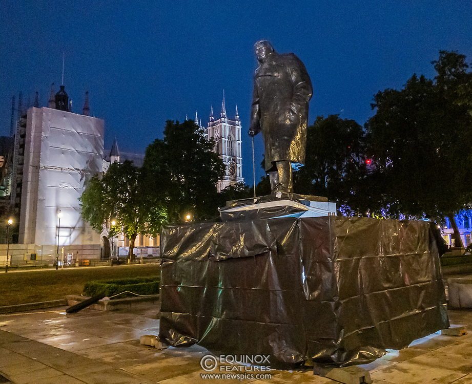 London, United Kingdom - 17 June 2020<br /> Police guard Winston Churchill statue. Its graffiti was being cleaned with solvents after the statue was uncovered from its protective scaffolding and sheet metal following Black Lives Matter protests, Parliament Square, London, England, UK.<br /> (photo by: EQUINOXFEATURES.COM)<br /> Picture Data:<br /> Photographer: Equinox Features<br /> Copyright: ©2020 Equinox Licensing Ltd. +443700 780000<br /> Contact: Equinox Features<br /> Date Taken: 20200617<br /> Time Taken: 22254334<br /> www.newspics.com