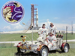 Cape Canaveral, FL - September 30, 1971 -- The prime crew for the Apollo 17 lunar landing mission are: Commander, Eugene A. Cernan (seated), Command Module pilot Ronald E. Evans (standing on right), and Lunar Module pilot, Harrison H. Schmitt. They are photographed with a Lunar Roving Vehicle (LRV) trainer. Cernan and Schmitt will use an LRV during their exploration of the Taurus-Littrow landing site. The Apollo 17 Saturn V Moon rocket is in the background. This picture was taken at Pad A, Launch Complex 39, Kennedy Space Center (KSC), Florida, The Apollo 17 emblem is in the photo insert at upper left..Photo by NASA via CNP /ABACAPRESS.COM
