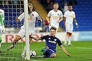 Hull City captain Michael Dawson (next to post) clears from Cardiff City's Joe Mason (on floor). Skybet football league championship match, Cardiff city v Hull city at the Cardiff city stadium in Cardiff, South Wales on Tuesday 15th Sept 2015.<br /> pic by Carl Robertson, Andrew Orchard sports photography.