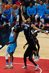 March 10, 2018 - Los Angeles, CA, U.S. - LOS ANGELES, CA - MARCH 10: LA Clippers forward Montrezl Harrell (5) shoots under the basket as Orlando Magic center Khem Birch (24) tries to knock it down during the game between the Orlando Magic and the LA Clippers on March 10, 2018, at STAPLES Center in Los Angeles, CA. (Photo by David Dennis/Icon Sportswire) (Credit Image: © David Dennis/Icon SMI via ZUMA Press)