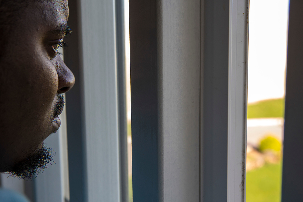 A prisoner looking out of his cell window. HMP/YOI Portland, Dorset, United Kingdom.