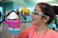 Making hand puppets at the Cesar Chavez Library's summer program for kids.