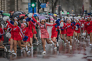 A large group of cheerleaders charge rounfd the last corner to finish in the pouring rain in Parliament Square - The New Years day parade passes through central London form Piccadilly to Whitehall. London 01 Jan 2017